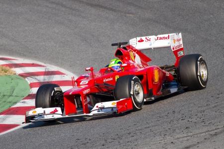 formula one racing: BARCELONA - FEBRUARY 24, 2012: Felipe Massa of Ferrari F1 team races during Formula One Teams Test Days at Catalunya circuity, Barcelona, Spain Editorial