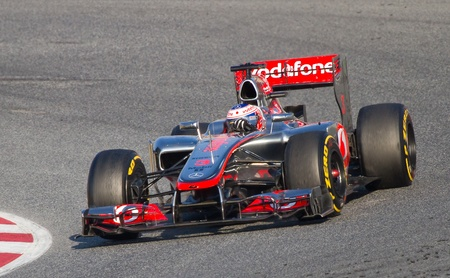 BARCELONA - FEBRUARY 24, 2012: Jenson Button of McLaren F1 team races during Formula One Teams Test Days at Catalunya circuity, Barcelona, Spain Stock Photo - 12778383