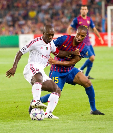 BARCELONA - SEPTEMBER 13: Clarence Seedorf and Seydou Keita (R) in action during the UEFA Champions League match between FC Barcelona and AC Milan, 2 - 2, on September 13, 2011, in Barcelona, Spain.