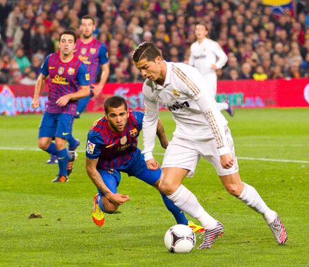 BARCELONA - JANUARY 25: Dani Alves and Cristiano Ronaldo in action during the Spanish Cup match between FC Barcelona and Real Madrid, final score 2 - 2, on January 25, 2012, in Barcelona, Spain. Editorial