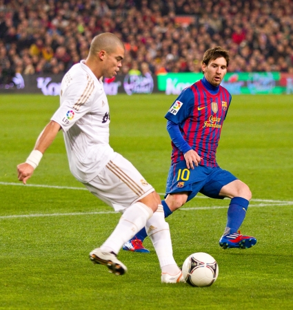 BARCELONA - JANUARY 25: Pepe Laveran and Leo Messi in action during the Spanish Cup match between FC Barcelona and Real Madrid, final score 2 - 2, on January 25, 2012, in Barcelona, Spain. Stock Photo - 13824175