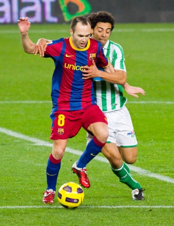 iniesta: BARCELONA - JANUARY 12: Andres Iniesta in action during football Spanish Cup match between FC Barcelona and Real Betis, final score 5 - 0. January 12, 2011 in Barcelona, Spain Editorial