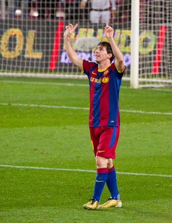 BARCELONA - JANUARY 12: Lionel Messi celebrating a goal during football Spanish Cup match between FC Barcelona and Real Betis, final score 5 - 0. January 12, 2011 in Barcelona, Spain