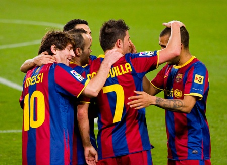 BARCELONA - JANUARY 12: Players celebrating a goal during football Spanish Cup match between FC Barcelona and Real Betis, final score 5 - 0. January 12, 2011 in Barcelona, Spain Stock Photo - 13685451