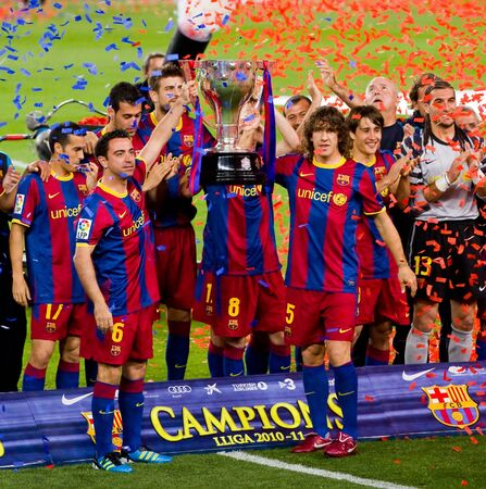 BARCELONA - MAY 15: FC Barcelona players celebrating the Spanish League Championship Trophy in Camp Nou stadium, on May 15, 2011 in Barcelona, Spain.