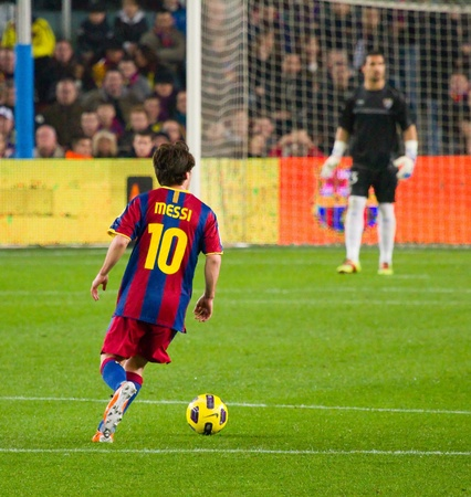 BARCELONA - JANUARY 16: Lionel Messi in action during the Spanish League match between FC Barcelona and Malaga, 4 - 1, at Camp Nou stadium. January 16, 2011 in Barcelona, Spain. Stock Photo - 14223905