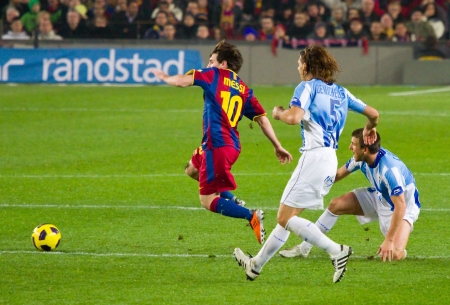 BARCELONA - JANUARY 16: Lionel Messi in action during the Spanish League match between FC Barcelona and Malaga, 4 - 1, at Camp Nou stadium. January 16, 2011 in Barcelona, Spain. Stock Photo - 14223907