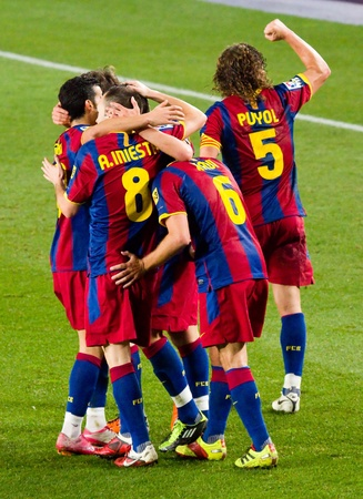 BARCELONA - JANUARY 16: FCB players celebrating a goal during the Spanish League match between FC Barcelona and Malaga, 4 - 1, at Camp Nou stadium. January 16, 2011 in Barcelona, Spain.