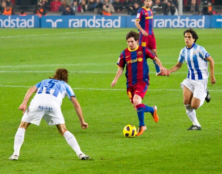 BARCELONA - JANUARY 16: Lionel Messi in action during the Spanish League match between FC Barcelona and Malaga, 4 - 1, at Camp Nou stadium. January 16, 2011 in Barcelona, Spain.