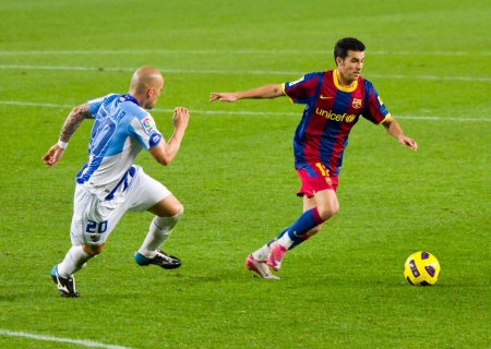 BARCELONA - JANUARY 16: Pedro Rodriguez in action during the Spanish League match between FC Barcelona and Malaga, 4 - 1, at Camp Nou stadium. January 16, 2011 in Barcelona, Spain.