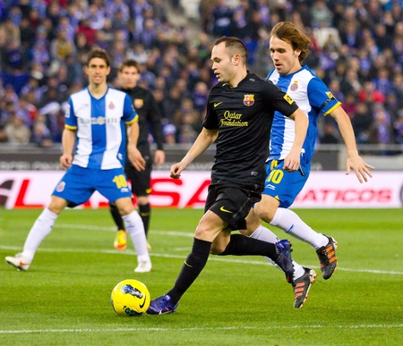 iniesta: BARCELONA, SPAIN - JANUARY 8: Andres Iniesta of FC Barcelona in action during the Spanish league match between RCD Espanyol and FC Barcelona, final score 1-1, on January 8, 2012, in Barcelona, Spain. Editorial