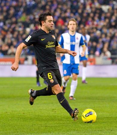 xavi: BARCELONA, SPAIN - JANUARY 8: Xavi Hernandez of FC Barcelona in action during the Spanish league match between RCD Espanyol and FC Barcelona, final score 1-1, on January 8, 2012, in Barcelona, Spain. Editorial