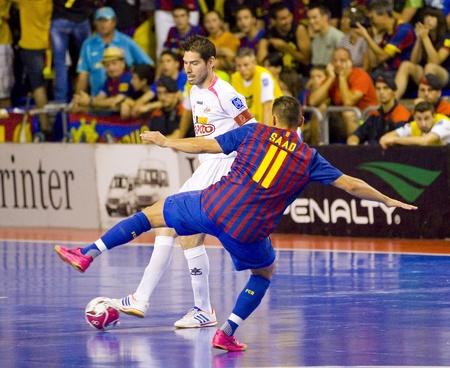BARCELONA, SPAIN - JUNE 17: Kike Boned (L) and Saad Assis in action at Spanish Futsal League match between FC Barcelona and El Pozo Murcia, final score 4 - 1, on June 17, 2012, in Barcelona, Spain.