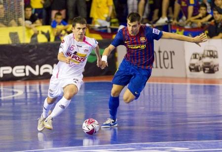 futsal: BARCELONA, SPAIN - JUNE 17: Alex Yepes -L- of El Pozo in action at Spanish Futsal League final match between FC Barcelona and El Pozo Murcia, final score 4 - 1, on June 17, 2012, in Barcelona, Spain.