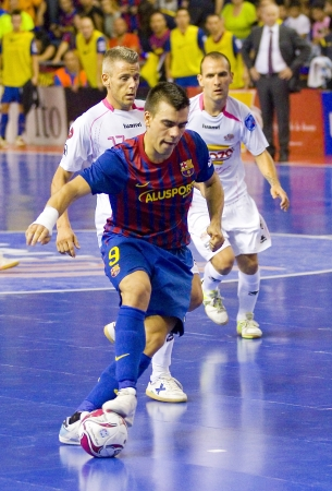 sergio: BARCELONA, SPAIN - JUNE 17: Sergio Lozano -9- of FCB in action at Spanish Futsal League final match between FC Barcelona and El Pozo Murcia, final score 4 - 1, on June 17, 2012, in Barcelona, Spain. Editorial