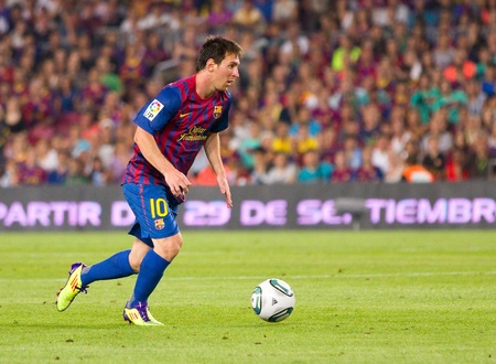 leo messi: BARCELONA - AUGUST 17: Leo Messi in action during the Spanish Super Cup final match between FC Barcelona and Real Madrid, final score 3 - 2, on August 17, 2011 in Camp Nou stadium, Barcelona, Spain