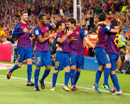 BARCELONA - AUGUST 17: Players celebrating the goal of Leo Messi during the Spanish Super Cup final match between FC Barcelona and Real Madrid, 3 - 2, on August 17, 2011 in Barcelona, Spain