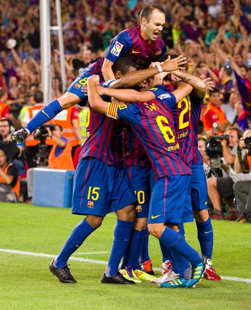 leo messi: BARCELONA - AUGUST 17: Players celebrating the goal of Leo Messi during the Spanish Super Cup final match between FC Barcelona and Real Madrid, 3 - 2, on August 17, 2011 in Barcelona, Spain