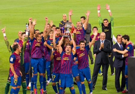 iniesta: BARCELONA - AUGUST 17: Barcelona players celebrate Spanish Supercup victory after beating Real Madrid (3 - 2) on August 17, 2011 in Camp Nou, Barcelona, Spain Editorial