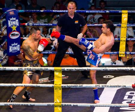 BARCELONA, SPAIN - OCTOBER 15: Juan Martos and Radjan El Assaoui in action during the fight4life Kick Boxing - 66 kg event, on October 15, 2011, in Barcelona, Spain
