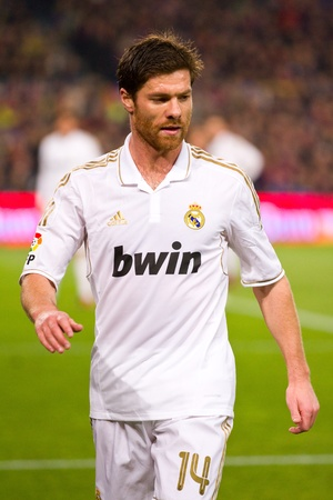 BARCELONA - JANUARY 25: Xabi Alonso of Madrid in action during the Spanish Cup match between FC Barcelona and Real Madrid, final score 2 - 2, on January 25, 2012, in Barcelona, Spain