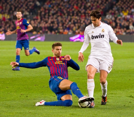 BARCELONA - JANUARY 25: Gerard Pique and Ricardo Kaka in action during the Spanish Cup match between FC Barcelona and Real Madrid, final score 2 - 2, on January 25, 2012, in Barcelona, Spain 에디토리얼