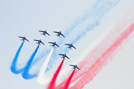 BARCELONA - OCTOBER 2: Unidentified pilots of Patrouille de France perform acrobatics during the aerial plane exhibition Festa al Cel festival, on October 2, 2011 in Barcelona, Spain Editorial
