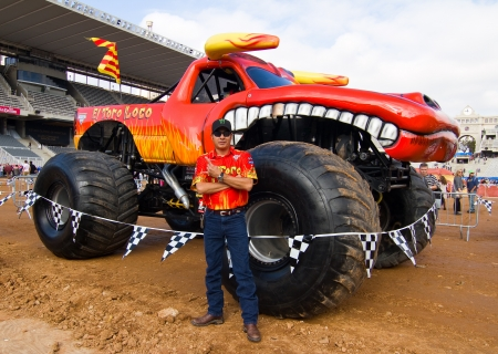 lupe: BARCELONA - NOVEMBER 12: Lupe Soza, driver of Toro Loco Monster Truck, poses for photos during a Monster Jam spectacle, on November 12, 2011, in sports competition Stadium, Barcelona, Spain