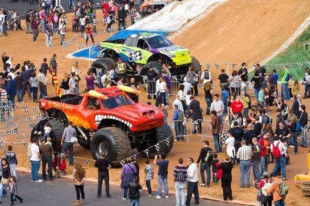 spectacle: BARCELONA, SPAIN - NOVEMBER 12: Unidentified people at a car exhibition during Monster Jam spectacle, on November 12, 2011, in sports competition Stadium, Barcelona, Spain Editorial