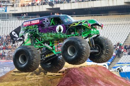 BARCELONA, SPAIN - NOVEMBER 12: Charlie Pauken driving the Grave Digger Monster Truck during a Monster Jam spectacle, on November 12, 2011, in sports competition Stadium, Barcelona, Spain