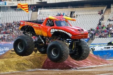 BARCELONA, SPAIN - NOVEMBER 12: Lupe Soza driving the Toro Loco Monster Truck during a Monster Jam spectacle, on November 12, 2011, in sports competition Stadium, Barcelona, Spain
