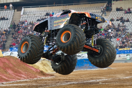 spectacle: BARCELONA, SPAIN - NOVEMBER 12: Tom Meents driving the Maximum Destruction Monster Truck during a Monster Jam spectacle, on November 12, 2011, in sports competition Stadium, Barcelona, Spain