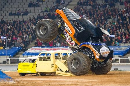 spectacle: BARCELONA, SPAIN - NOVEMBER 12: Charles Benns driving the Mutt Rottweiler Monster Truck during a Monster Jam spectacle, on November 12, 2011, in Olympic Stadium, Barcelona, Spain Editorial
