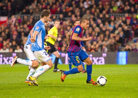 dani: BARCELONA - JANUARY 4: Dani Alves of Barcelona in action during the Spanish Cup match between FC Barcelona and Osasuna, final score 4 - 0, on January 4, 2012 in Camp Nou stadium, Barcelona, Spain