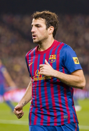 BARCELONA - JANUARY 4: Cesc Fabregas of Barcelona in action during the Spanish Cup match between FC Barcelona and Osasuna, final score 4 - 0, on January 4, 2012 in Camp Nou stadium, Barcelona, Spain