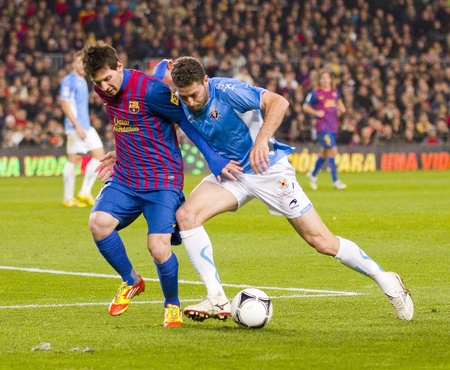 BARCELONA - JANUARY 4: Lionel Messi of Barcelona in action during the Spanish Cup match between FC Barcelona and Osasuna, final score 4 - 0, on January 4, 2012 in Camp Nou stadium, Barcelona, Spain Stock Photo - 14681409