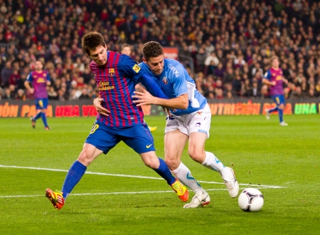 BARCELONA - JANUARY 4: Lionel Messi of Barcelona in action during the Spanish Cup match between FC Barcelona and Osasuna, final score 4 - 0, on January 4, 2012 in Camp Nou stadium, Barcelona, Spain Stock Photo - 14681419