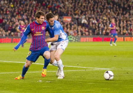 BARCELONA - JANUARY 4: Lionel Messi of Barcelona in action during the Spanish Cup match between FC Barcelona and Osasuna, final score 4 - 0, on January 4, 2012 in Camp Nou stadium, Barcelona, Spain Stock Photo - 14681423