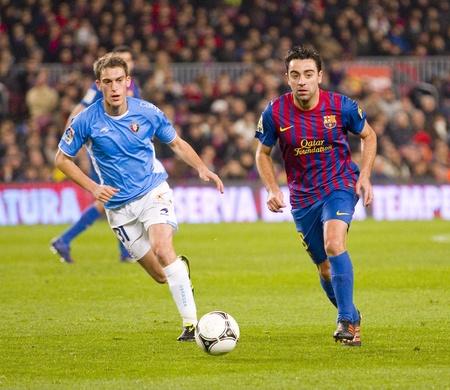 xavi: BARCELONA - JANUARY 4: Xavi Hernandez of Barcelona in action during the Spanish Cup match between FC Barcelona and Osasuna, final score 4 - 0, on January 4, 2012 in Camp Nou stadium, Barcelona, Spain Editorial