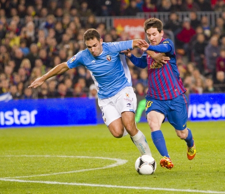 BARCELONA - JANUARY 4: Leo Messi of Barcelona in action during the Spanish Cup match between FC Barcelona and Osasuna, final score 4 - 0, on January 4, 2012 in Camp Nou stadium, Barcelona, Spain Stock Photo - 14681362