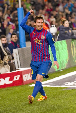 BARCELONA - JANUARY 4: Leo Messi celebrating a goal during the Spanish Cup match between FC Barcelona and Osasuna, final score 4 - 0, on January 4, 2012 in Camp Nou stadium, Barcelona, Spain