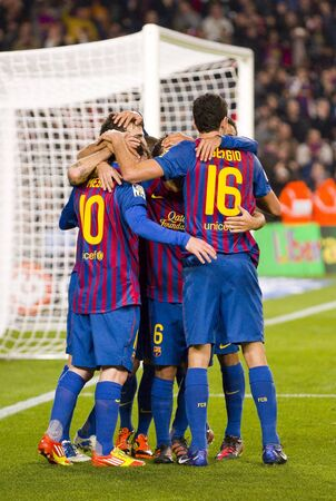 BARCELONA - JANUARY 4: Barcelona players celebrating a goal during the Spanish Cup match between FC Barcelona and Osasuna, final score 4 - 0, on January 4, 2012 in Camp Nou stadium, Barcelona, Spain