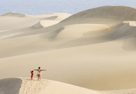 Woman and baby breathing air in the dunes of Maspalomas, Canary islands, Spain