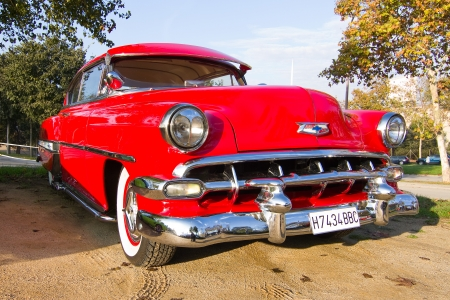 bel air: BARCELONA - NOVEMBER 12: A 1954 red Chevrolet Bel Air on display at a classic car show during Monster Jam Party, on November 12, 2011, in Olympic Stadium, Barcelona, Spain Editorial