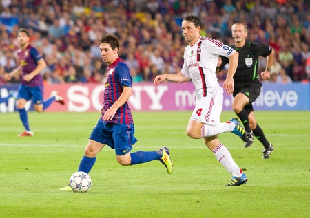 leo messi: BARCELONA - SEPTEMBER 13: Leo Messi in action during the UEFA Champions League match between FC Barcelona and AC Milan, final score 2 - 2, on September 13, 2011, in Camp Nou stadium, Barcelona, Spain