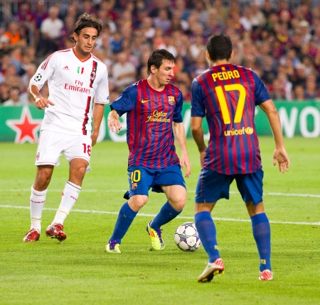 BARCELONA - SEPTEMBER 13: Leo Messi in action during the UEFA Champions League match between FC Barcelona and AC Milan, final score 2 - 2, on September 13, 2011, in Camp Nou stadium, Barcelona, Spain