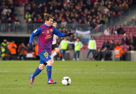 leo messi: BARCELONA - FEBRUARY 2: Leo Messi in action during the Spanish Cup match between FC Barcelona and Valencia CF, final score 2-0, on February 2, 2012, in Camp Nou stadium, Barcelona, Spain