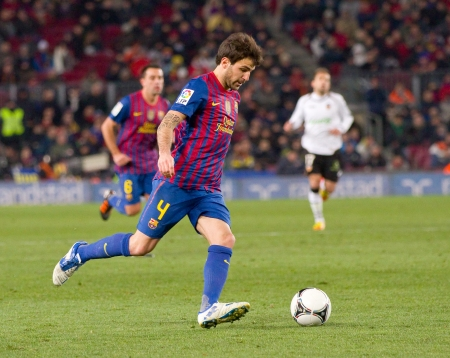 cesc: BARCELONA - FEBRUARY 2: Cesc Fabregas in action during the Spanish Cup match between FC Barcelona and Valencia CF, final score 2-0, on February 2, 2012, in Camp Nou stadium, Barcelona, Spain
