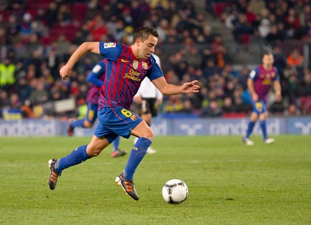 xavi: BARCELONA - FEBRUARY 2: Xavi Hernandez in action during the Spanish Cup match between FC Barcelona and Valencia CF, final score 2-0, on February 2, 2012, in Camp Nou stadium, Barcelona, Spain