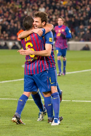fabregas: BARCELONA - FEBRUARY 2: Barcelona players celebrate a goal during the Spanish Cup match between FC Barcelona and Valencia, final score 2-0, on February 2, 2012, in Camp Nou stadium, Barcelona, Spain Editorial